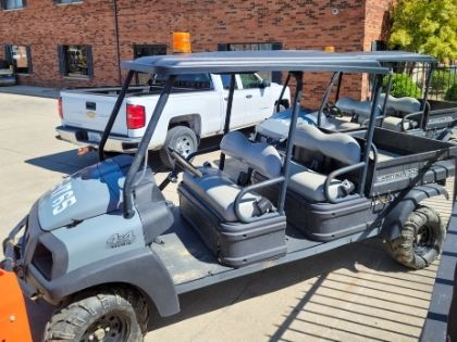 A large golf cart parked in a parking lot.