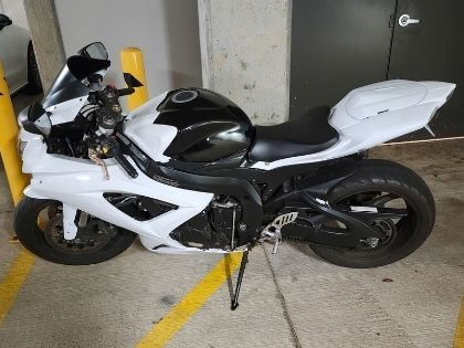 A white motor bike parked in a parking garage