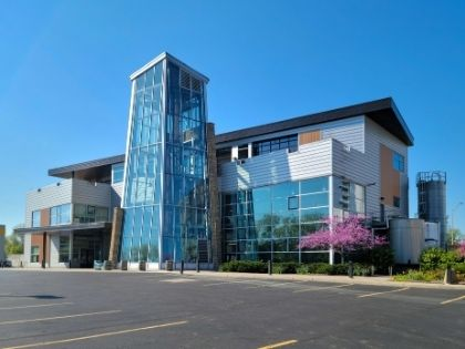 A large commercial office building with many windows.