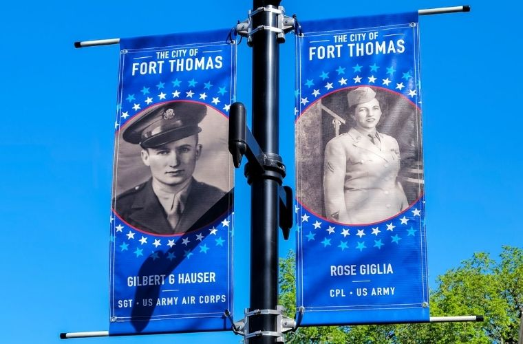Banners hung from a streetlamp celebrating the history of Fort Thomas