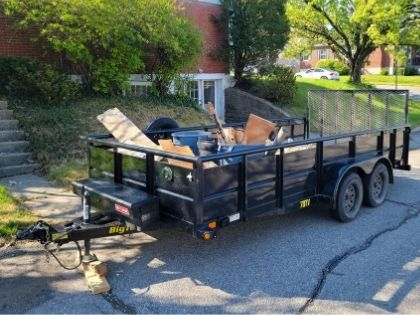 A flatbed trailer loaded with junk to be hauled away