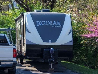 A large white and gray Kodiak RV