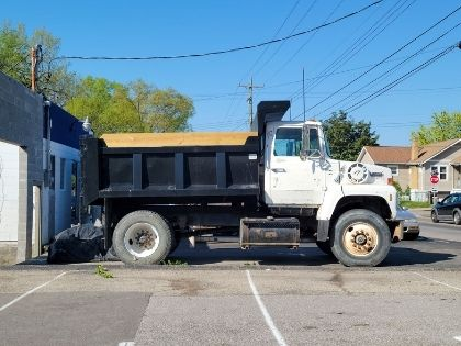 A large commercial truck used to haul debris. The truck is white.